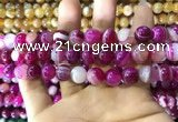 CAA1564 15.5 inches 12mm round banded agate beads wholesale
