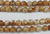 CAG1885 15.5 inches 6mm faceted round lemon crazy lace agate beads