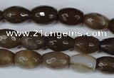 CAG3129 15.5 inches 10*14mm faceted rice brown line agate beads