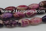 CDE30 15.5 inches 8*12mm rice dyed sea sediment jasper beads