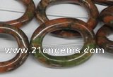 CFG271 15.5 inches 24*30mm carved oval unakite gemstone beads