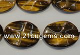 CTE832 15.5 inches 18*25mm wavy oval yellow tiger eye beads